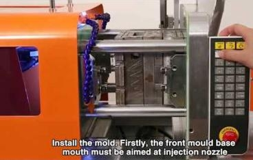 Automated all electric desktop injection molding machine