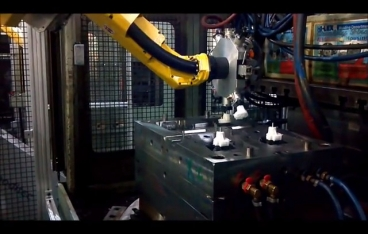 Automated injection molding machine